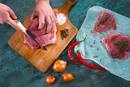 butcher-cutting-pork-meat-on-kitchen-P8BM7YW.jpg